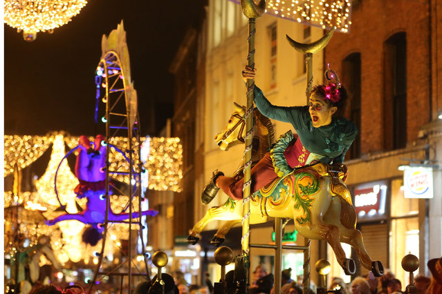 People take part in the Procession of Light through the centre of Dublin, Ireland to begin the city's New Year's eve festival, on December 31, 2014. (Photo by Niall Carson/PA Wire/ZUMA Press)