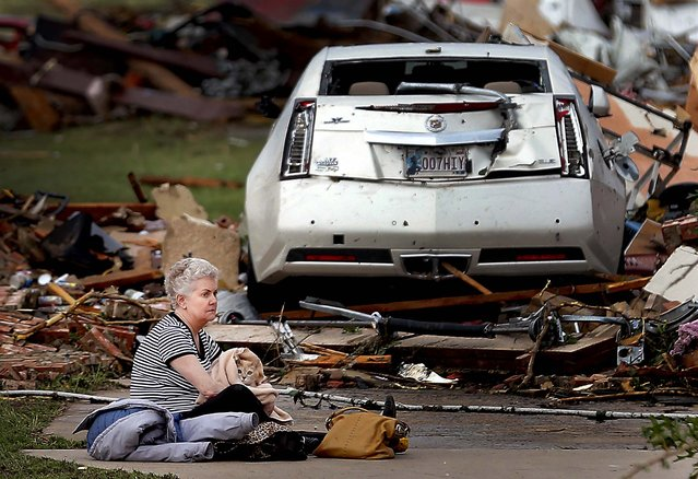 Kay James holds her cat as she sits in her driveway after her home in Oklahoma City was destroyed by the tornado. (Photo by Chris Landsberger/The Oklahoman)