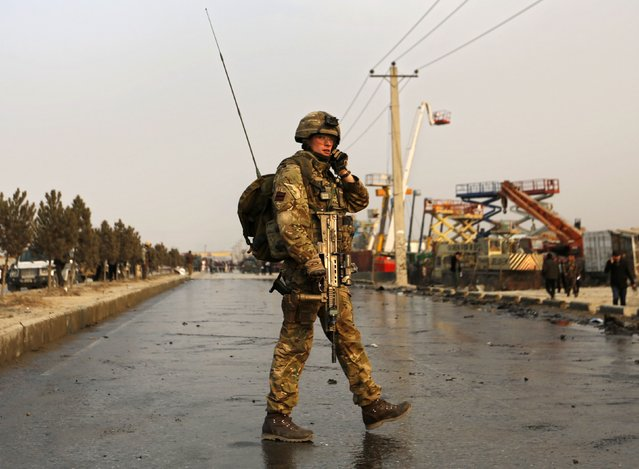 A British soldier stands guard at a road at the site of a suicide attack in Kabul January 5, 2015. (Photo by Mohammad Ismail/Reuters)