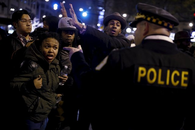 Demonstrators argue with police officers during a protest in response to the fatal shooting of Laquan McDonald in Chicago, Illinois, November 25, 2015. (Photo by Andrew Nelles/Reuters)