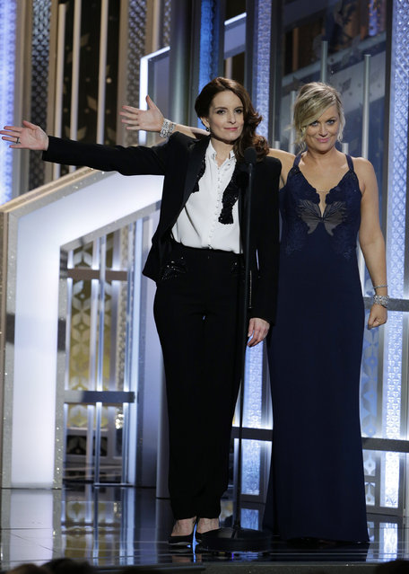 In this handout photo provided by NBCUniversal, Hosts Tina Fey and Amy Poehler speak onstage during the 72nd Annual Golden Globe Awards at The Beverly Hilton Hotel on January 11, 2015 in Beverly Hills, California. (Photo by Paul Drinkwater/NBCUniversal via Getty Images)