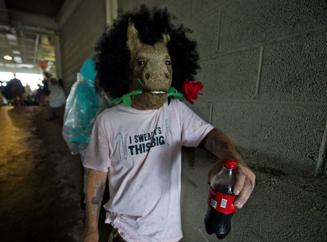 A man wears a horse mask with a rose on Kentucky Derby Day at Churchill Downs on May 5, 2018 in Louisville, Ky. (Photo by Scott Serio/Eclipse Sportswire/Getty Images)