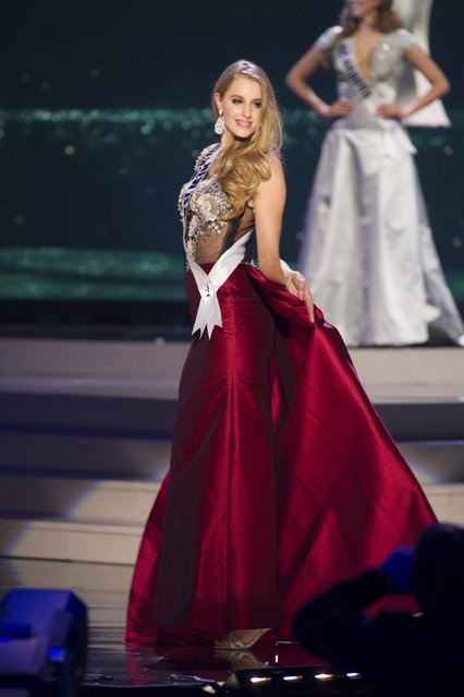 Rachel Millns, Miss New Zealand 2014 competes on stage in her evening gown during the Miss Universe Preliminary Show in Miami, Florida in this January 21, 2015 handout photo. (Photo by Reuters/Miss Universe Organization)