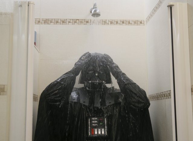 Darth Mykolaiovych Vader, who is dressed as the 'Star Wars' character Darth Vader, poses for a picture as he takes a shower in a bathroom at his apartments in Odessa, Ukraine, December 4, 2015. (Photo by Valentyn Ogirenko/Reuters)