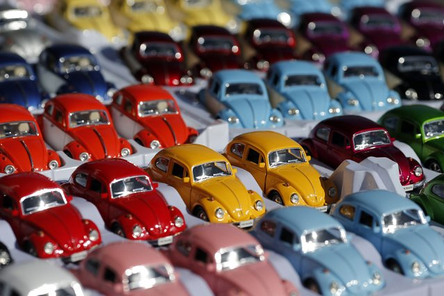 Miniature models of Volkswagen beetle are displayed during a Volkswagen Beetle owners' meeting in Sao Bernardo do Campo January 25, 2015. (Photo by Paulo Whitaker/Reuters)