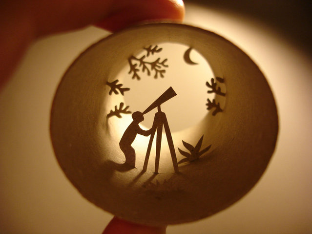 Toilet paper roll art of a man looking through a telescope. (Photo by Anastassia Elias/Caters News)