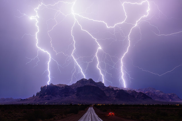 Superstrike: Mike's favourite image of the year which hit the Superstition Mountains near Phoenix on July 3, 2015 in Arizona, United States. (Photo by Mike Olbinski/Barcroft Media)