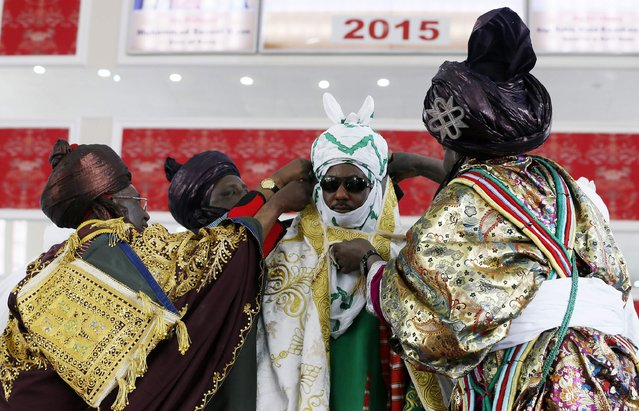 New Emir of Kano Muhamadu Sanusi II (C) is dressed by the Kingmakers, a traditional role charged with officially dressing the king, during his coronation in Kano, Kano State, February 7, 2015. (Photo by Afolabi Sotunde/Reuters)