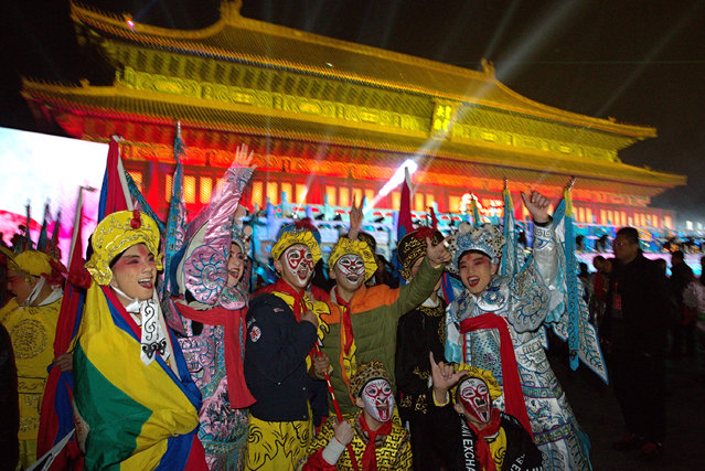 Performers pose for photos before the countdown to the New Year at an event in Beijing, China, Thursday, December 31, 2015. (Photo by Ng Han Guan/AP Photo)