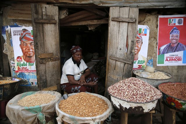 Latefat Alao, 56, a ethnic Yoruba Muslim woman, waits for customers in front of her in Beere market in Ibadan, southwest Nigeria, January 29, 2015. Much of the grain and wheat traders like Alao sell comes from the north and Boko Haram's campaign has negatively affected farmers and food markets. (Photo by Akintunde Akinleye/Reuters)