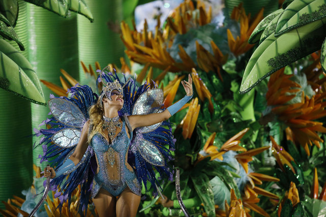 A performer from the Portela samba school parades during Carnival celebrations at the Sambadrome in Rio de Janeiro, Brazil, Monday, February 16, 2015. (Photo by Leo Correa/AP Photo)