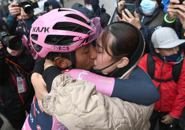 Colombian rider Egan Arley Bernal Gomez of Ineos Grenadiers team (L) kiss his wife (R) after winning and retaining the overall leader's pink jersey winning the 16th stage of the 2021 Giro d'Italia cycling race over 212km from Salice to Cortina D'Ampezzo, Italy, 24 May 2021. (Photo by Marco Alpozzi/EPA/EFE/Pool)