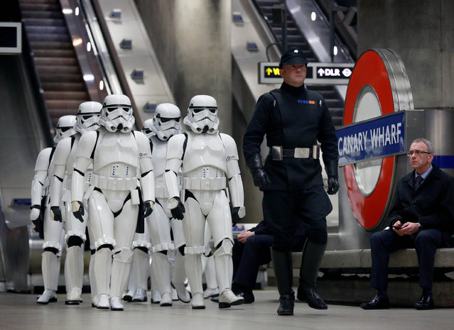 A group of Star Wars enthusiasts dressed as Stormtroopers descend on Canary Wharf underground station in London, to mark the release of the new Star Wars movie Rogue One: A Star Wars Story, Thursday December 15, 2016. Canary Wharf features in the movie. (Photo by Matt Alexander/PA Wire via AP Photo)