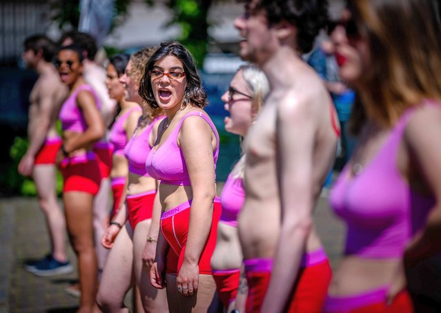 Students protest in red underwear on the Plein in The Hague, The Netherlands, 02 June 2021. The action is part of the #NietMijnSchuld campaign by Dutch union FNV Young & United and the National Student Union LSVb, which are campaigning for a debt-free basic grant. (Photo by Bart Maat/EPA/EFE)