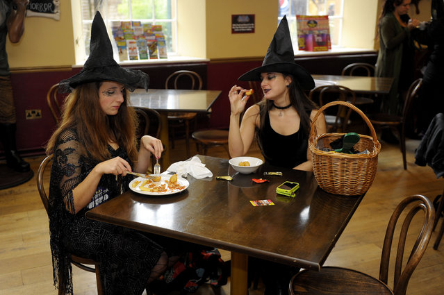 Aspiring witches have lunch during auditions for the new witch of Wookey Hole Caves during trials held at the Somerset tourist attraction, on October 22, 2013. Around 50 applicants took part in the auditions today for a £50,000 a year (pro rata) job as the face of Wookey Hole. (Photo by Tim Ireland/PA Wire)