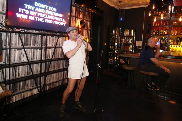 Todd Slinkard, 41, sings at the first annual Underwear Karaoke, an event that pairs two common fears: being seen in your underwear and singing in public, in Los Angeles, California March 12, 2015. (Photo by Lucy Nicholson/Reuters)