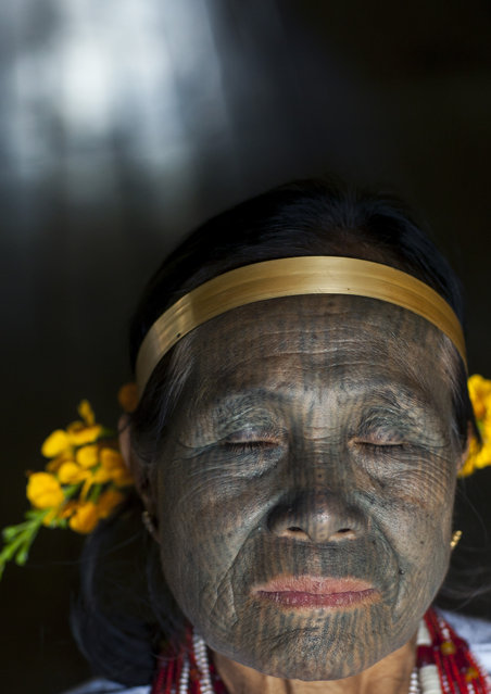 A woman with a rare full-face tattoo. She comes from the Kanpelet village, home to women from the U Pu tribe , in February, 2015, in Myanmar, Burma. (Photo by Eric Lafforgue/Barcroft Media)