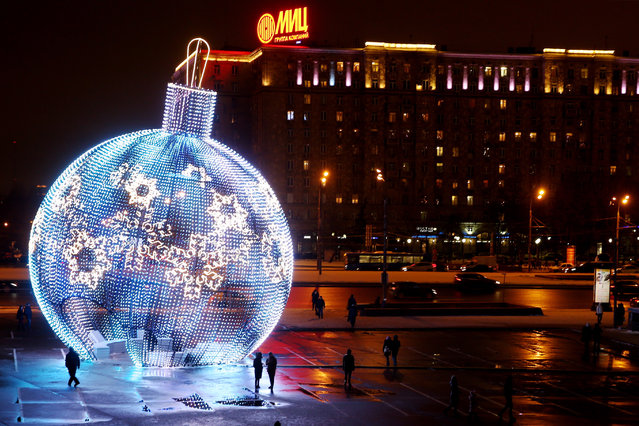 A giant Christmas ball near Park Pobedy metro station in Moscow, Russia on December 19, 2016. (Photo byTASS/Barcroft Images)