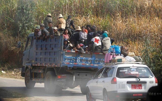 A truck carrying civilians displaced by fighting and volunteer rescue workers is seen as it travels as part of a Red Cross convoy, between Laukkai, the capital of the Kokang region, and Chinshwehaw February 17, 2015. (Photo by Soe Zeya Tun/Reuters)