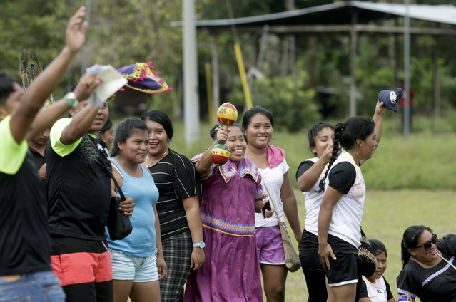In this November 25, 2018 photo, Ngabe-Bugle indigenous women support their women's soccer team during the second edition of the Panamanian indigenous games in Piriati, Panama. Ngabe-Bugle is the largest and most populous of Panama's three Indigenous regions. (Photo by Arnulfo Franco/AP Photo)