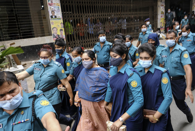 Bangladeshi journalist Rozina Islam, center, is escorted by police to a court in Dhaka, Bangladesh, Tuesday, May 18, 2021. Police in Bangladesh's capital have arrested the prominent journalist on charges of stealing and photographing sensitive state information. (Photo by Mahmud Hossain Opu/AP Photo)