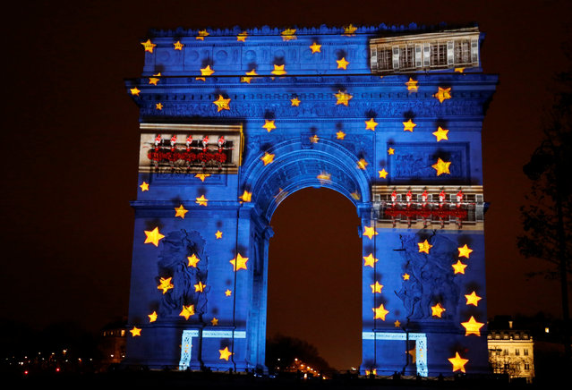 View of a light show on the city's iconic Arc de Triomphe monument during the New Year celebration in Paris, France, December 31, 2016. (Photo by Jacky Naegelen/Reuters)