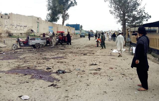 Afghan men inspect the site of a suicide attack in Khost city, Afghanistan, Thursday, April 2, 2015. A suicide bomber attacked an anti-corruption demonstration in eastern Afghanistan on Thursday, killing more than a dozen people and wounding tens, an official said. (Photo by Nasim Liwal/AP Photo)