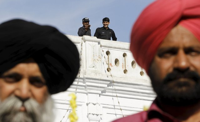 Pakistani police stand guard as Sikh devotees participate in the Baisakhi festival at Panja Sahib shrine in Hassan Abdel April 13, 2015. (Photo by Caren Firouz/Reuters)