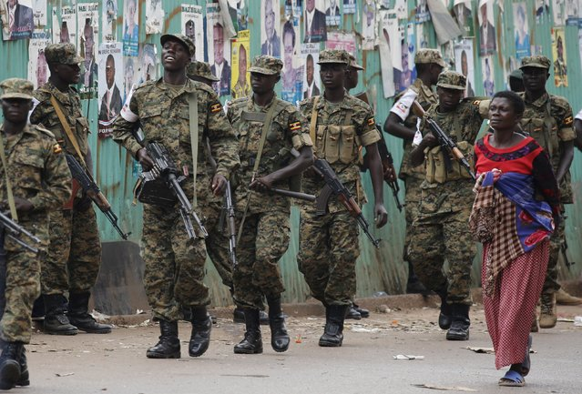 Ugandan soldiers patrol a street in Kampala, Uganda February 20, 2016. (Photo by Goran Tomasevic/Reuters)