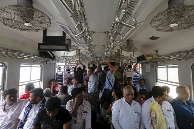 Commuters travel by suburban train as they head toward their destination in Mumbai, India, February 17, 2016. India is the world's fastest-growing major economy, yet the government might break its budget deficit targets to stimulate demand, potentially undermining the central bank's fight against inflation. (Photo by Shailesh Andrade/Reuters)