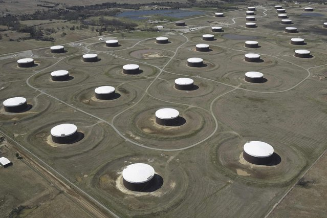 Crude oil storage tanks are seen from above at the Cushing oil hub, in Cushing, Oklahoma, March 24, 2016. (Photo by Nick Oxford/Reuters)