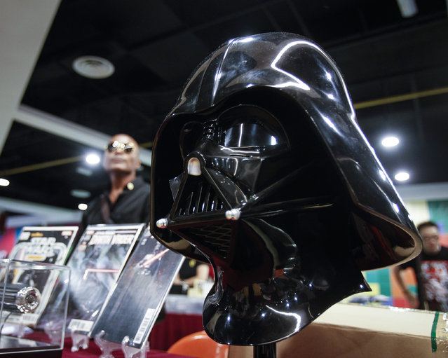 A life-sized Darth Vader helmet is seen on display at a Star Wars Day gathering in a mall downtown Kuala Lumpur, Malaysia, Saturday, May 2, 2015. (Photo by Joshua Paul/AP Photo)