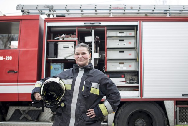 Volunteer firefighter Eniko Nagy poses in front of a fire truck in the yard of the Budaors Fire Services Department building in Budaors, a south western suburb of Budapest, Hungary, 05 March 2016. (Photo by Bea Kallos/EPA)