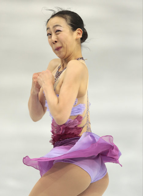 Mao Asada of Japan competes in the women's team short program figure skating competition at the Iceberg Skating Palace during the 2014 Winter Olympics, Saturday, February 8, 2014, in Sochi, Russia. (Photo by Ivan Sekretarev/AP Photo)
