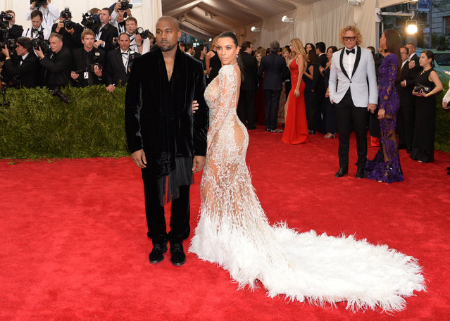 """Kanye West and Kim Kardashian arrives at The Metropolitan Museum of Art's Costume Institute benefit gala celebrating """"China: Through the Looking Glass"""" on Monday, May 4, 2015, in New York. (Photo by Evan Agostini/Invision/AP Photo)"""