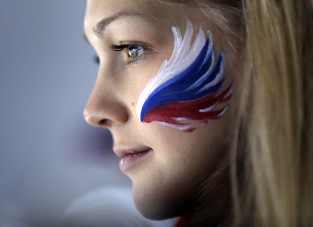 A Russian fan wears face paint while attending men's curling competition at the 2014 Winter Olympics, Monday, February 17, 2014, in Sochi, Russia. (Photo by Robert F. Bukaty/AP Photo)