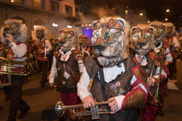 Masked Guggen music bands parade through the streets on the occasion of the beginning of the Fasnacht Carnival of Lucerne, Switzerland, early 23 February 2017. (Photo by Urs Flueeler/EPA)