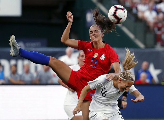 United States' Alex Morgan (13) and New Zealand's Katie Duncan (16) vie for the ball during the first half of an international friendly soccer match Thursday, May 16, 2019, in St. Louis. (Photo by Jeff Roberson/AP Photo)