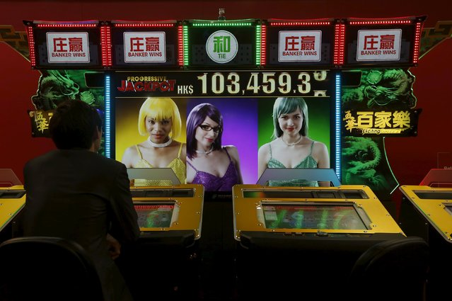 A visitor tries a baccarat game at the Global Gaming Expo (G2E) Asia in Macau, China May 19, 2015. (Photo by Bobby Yip/Reuters)