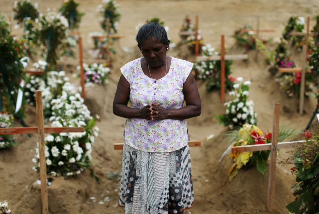 A woman reacts during mass burials near St. Sebastian church in Negombo, Sri Lanka on April 28, 2019. (Photo by Athit Perawongmetha/Reuters)