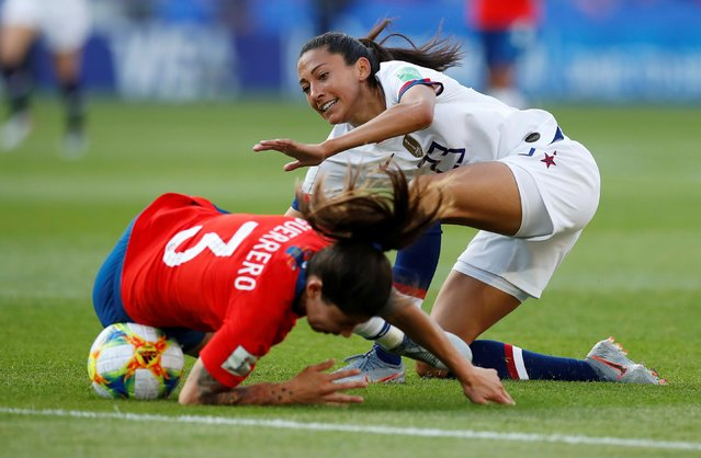 Chile's defender Carla Guerrero (L) vies with United States' forward Christen Press during the France 2019 Women's World Cup Group F football match between USA and Chile, on June 16, 2019, at the Parc des Princes stadium in Paris. (Photo by Christian Hartmann/Reuters)