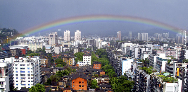 A rainbow appears in the sky after rainstorms following the landing of typhoon Haitang