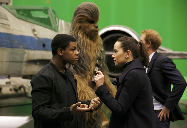 British actors John Boyega and Daisy Ridley (R) speak while Britain's Prince Harry talks with Chewbacca during tour of the Star Wars sets at Pinewood studios in Iver Heath, west of London, Britain on April 19, 2016. (Photo by Adrian Dennis/Reuters)