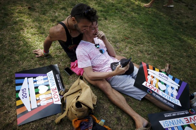 Scotty Seidenglanz, 18, (R) and Noah Ulin, 20, attend a celebration rally in West Hollywood, California, United States, June 26, 2015. (Photo by Lucy Nicholson/Reuters)