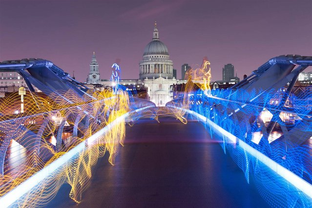 Undated handout photo issued by Fever PR of free running team 3RUN recreating scenes from the new Playstation 4 title inFamous Second Son whilst wearing neon suits on the Millennium Bridge in central London. (Photo by Andy Whyte/PA Wire/Fever PR)