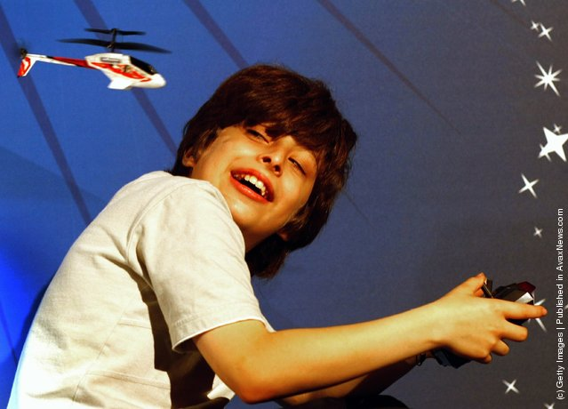 A young boy plays with a Silver lit Picooz remote control helicopter during the Dream Toys 2007 Christmas predictions fair