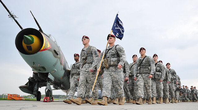 U.S. paratroopers are walking on the tarmac after being flown into the air base in Swidwin, Poland, on Wednesday, April 23, 2014 for weeks of joint exercise. Their arrival was requested by Poland as a way of increasing security at a time of conflict between two of its neighbors: Ukraine and Russia. (Photo by Lukasz Szelemej/AP Photo)