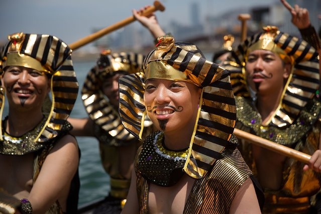 Dragon boat racers prepare for the fancy dress race on July 5, 2015 in Hong Kong, Hong Kong. The Hong Kong Dragon Boat Carnival will be staged from 3 July 2015 (Friday) to 5 July 2015 (Sunday). The carnival featured two key programmes: the CCB (Asia) Hong Kong International Dragon Boat Races in Victoria Harbour and the San Miguel BeerFest at the UC Centenary Garden in East Tsim Sha Tsui. (Photo by Taylor Weidman/Getty Images for Hong Kong Images)