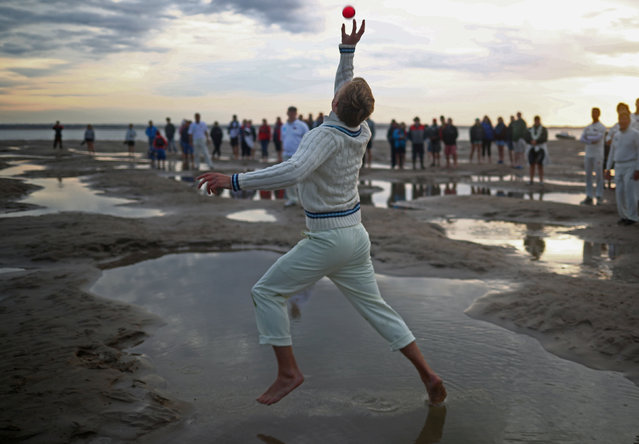 A player participates in the annual Brambles Sandbank cricket match at low tide in the Solent, Britain, September 1, 2019. (Photo by Hannah McKay/Reuters)