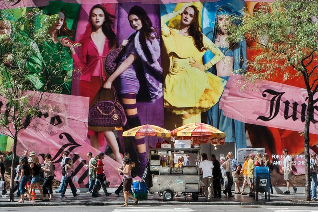 Pedestrians walk by a Juicy Couture billboard on 5th Avenue in New York, September 7, 2008. (Photo by Natan Dvir/Polaris)
